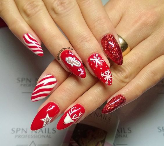 28 Most Beautiful and Elegant Christmas Stiletto Nail Designs; Stiletto nail; red Christmas nails; snowflakes nails; candy cane stripes nails.