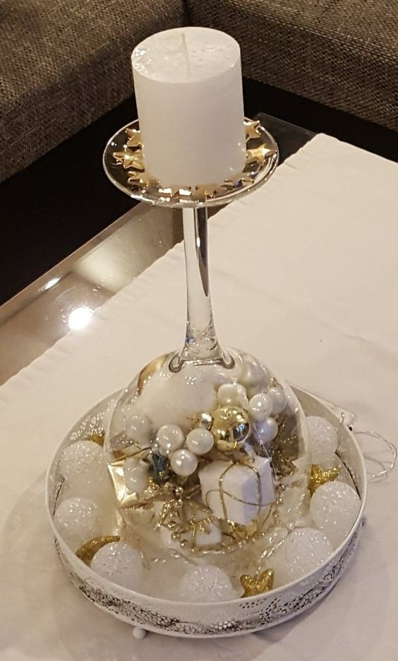 Christmas wine glass candle holder ; DIY Home Decor Ideas; beautiful Christmas decor; Christmas wine glass snow globe; cheap and easy candle holders.